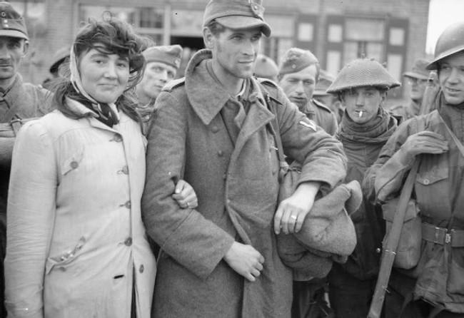 A Dutch woman refuses to leave her husband, a German soldier, after Allied soldiers capture him. She followed him into captivity. [1944]